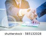 handshake concept.two... | Shutterstock . vector #585132028