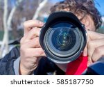 a man with a camera | Shutterstock . vector #585187750