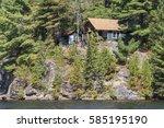 cottage on canoe lake in... | Shutterstock . vector #585195190