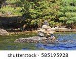 inukshuk standing on a rock on... | Shutterstock . vector #585195928