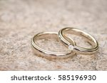 wedding rings on stone surface  ... | Shutterstock . vector #585196930