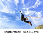 the first jump off the cliff... | Shutterstock . vector #585213598