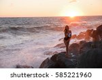 girl in a bathing suit on the... | Shutterstock . vector #585221960