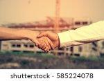two contractors shake hands | Shutterstock . vector #585224078