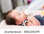 portrait of a little adorable... | Shutterstock . vector #585235199