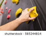 hand climber clinging tightly... | Shutterstock . vector #585244814