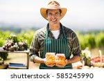 portrait of a smiling farmer... | Shutterstock . vector #585245990
