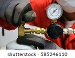 officer turning valve on gas...   Shutterstock . vector #585246110