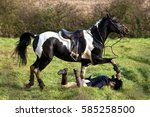 Small photo of Horse rider Falling off her Horse