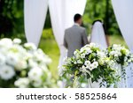 White flowers decorations during outdoor wedding ceremony - stock photo