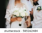 groom with white boutonniere on ... | Shutterstock . vector #585262484