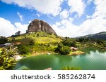 guatape is a small  very pretty ... | Shutterstock . vector #585262874