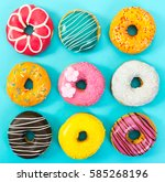 Various Colorful Donuts On Blu...