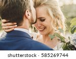 bearded groom kisses bride's... | Shutterstock . vector #585269744