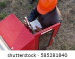 safety officials checking a... | Shutterstock . vector #585281840