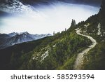 hiking trail through forested... | Shutterstock . vector #585293594