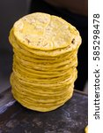 yellow corn tortillas in comal... | Shutterstock . vector #585298478