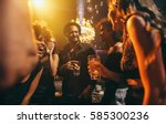 Stock photo image group of friends enjoying a party at pub happy young people having fun at nightclub 585300236