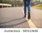 Woman Walking Alone On Street.