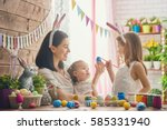 a mother and her daughter are... | Shutterstock . vector #585331940