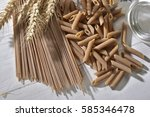 whole wheat pasta semolina on a ... | Shutterstock . vector #585346478
