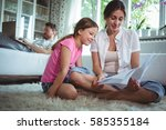mother and daughter looking at... | Shutterstock . vector #585355184