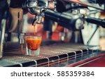 a falling drop of coffee in a... | Shutterstock . vector #585359384
