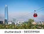 The cable way with different colored cabins on the background of Santiago, Chile.