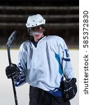 young ice hockey player... | Shutterstock . vector #585372830