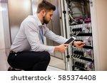 technician using digital tablet ...   Shutterstock . vector #585374408