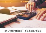 woman using calculator with... | Shutterstock . vector #585387518