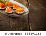 plate of smoked salmon canapes... | Shutterstock . vector #585391166