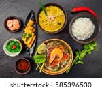asian food served on black... | Shutterstock . vector #585396530