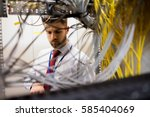 technician checking cables in a ... | Shutterstock . vector #585404069