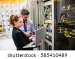 technicians using laptop while... | Shutterstock . vector #585410489