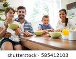 portrait of family having... | Shutterstock . vector #585412103