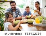 portrait of family having... | Shutterstock . vector #585412199
