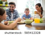 happy family interacting while... | Shutterstock . vector #585412328
