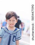 portrait of young sailor boy... | Shutterstock . vector #585447590