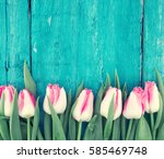 Stock photo frame of tulips on turquoise rustic wooden background spring flowers spring background greeting 585469748