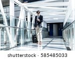 young man carrying a carry bag... | Shutterstock . vector #585485033
