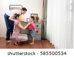 father and mother dressing her... | Shutterstock . vector #585500534