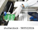 man working in an electronics... | Shutterstock . vector #585522026