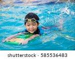 boy learn to swim in the... | Shutterstock . vector #585536483