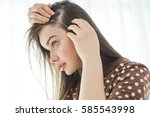 woman with problematic hair  | Shutterstock . vector #585543998