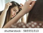 woman with problematic hair | Shutterstock . vector #585551513