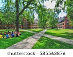 Small photo of YALE UNIVERSITY, NEW HAVEN, CONNECTICUT, USA - CIRCA 2015: Old campus quad with paved walkways passing diagonally through the grass lawn. Student housing dorms and faculty buildings surround the quad.