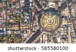 road roundabout with car lots... | Shutterstock . vector #585580100