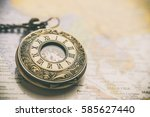 vintage pocket watch on old... | Shutterstock . vector #585627440
