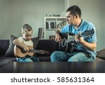 father teaching his son to play ...   Shutterstock . vector #585631364